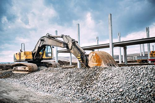 Excavator hauld away debris on construction site in Ottawa, Ontario.