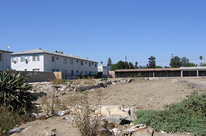 Cleared land after a house demolition.