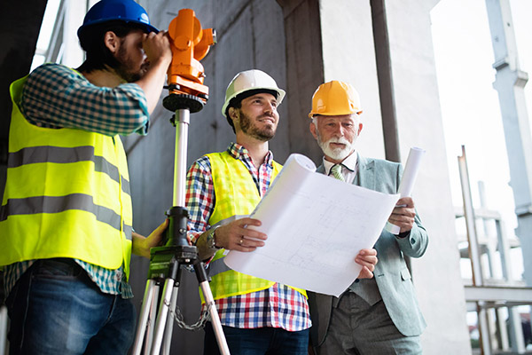 group-of-construction-engineer-working-in-construc-MZSKC3P-scaled