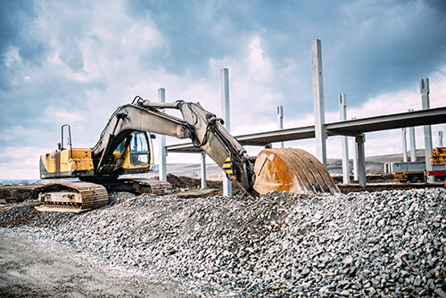 industrial-machinery-on-highway-construction-site-PRUQ875-1